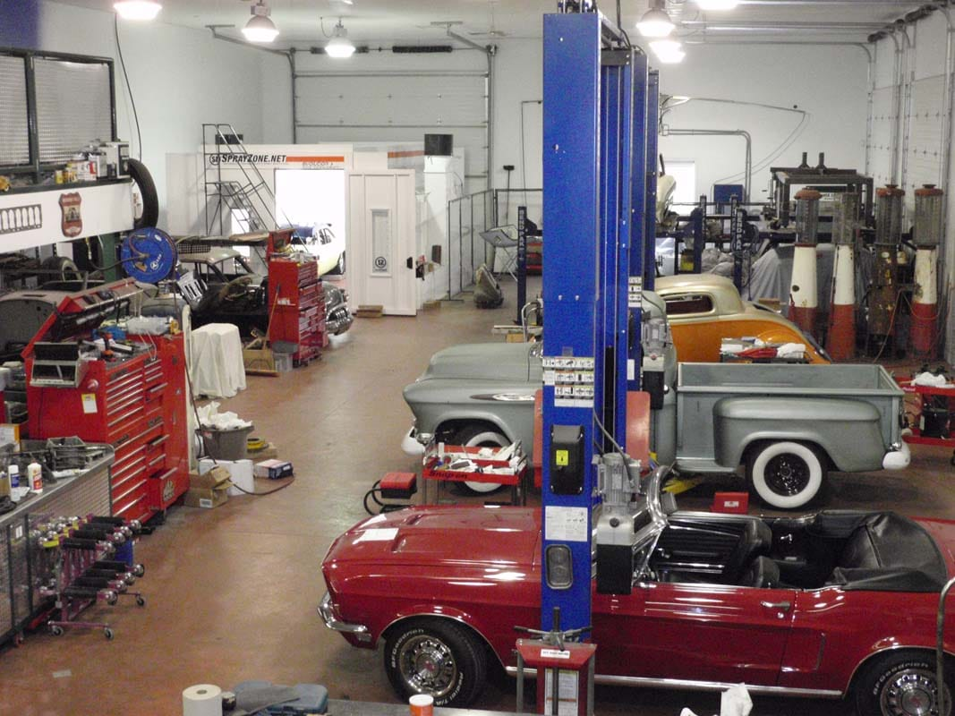 classic cars being rebuilt in a shop
