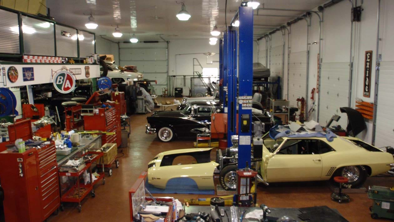 classic cars being rebuilt in the shop